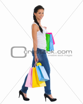 Full length portrait of smiling girl with shopping bags