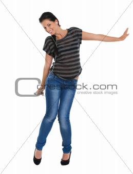 Full length portrait of smiling girl with headphones dancing
