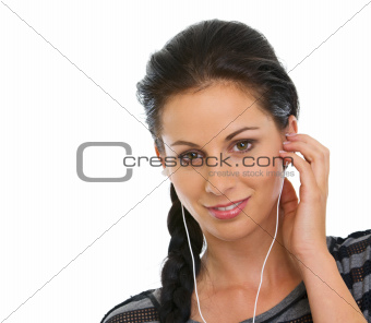 Portrait of happy girl listening music in headphones