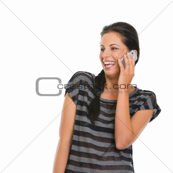 Happy girl speaking mobile phone and looking on copy space