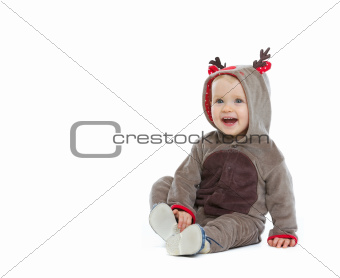 Smiling baby in Christmas costume looking on copy space