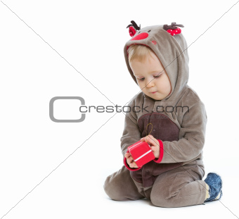 Baby checking little Christmas present box