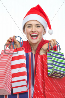 Happy woman in Christmas hat with shopping bags
