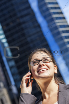 Woman or Businesswoman Talking on Cell Phone in City