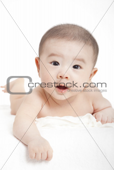 asian Baby boy  lying and looking at camrea