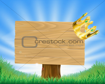 Golden crown hanging on sign