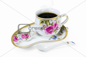 Set of cups of steaming coffee or tea and cream isolated on white