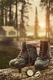 Hiking boots with compass at campsite