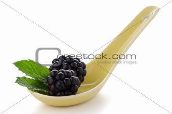 Blackberries in ceramic spoon