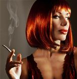 Luxury close up portrait of attractive girl with cigarette