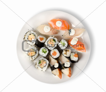 Sushi and rolls in a plate isolated