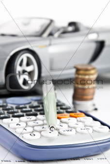 Car, Calculator, Money and Pen