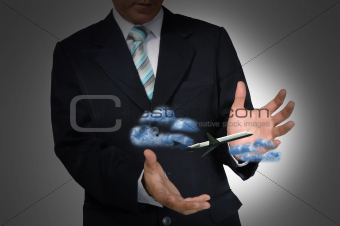 Airplane in the hand of business man