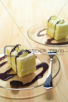 fresh cream cake closeup with chocolate sauce