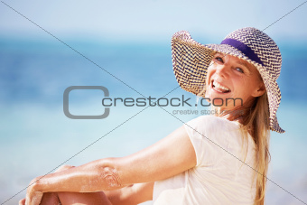 Portrait of beautiful woman enjoying sunny day on beach