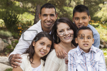 Happy Attractive Hispanic Family Portrait Outdoors In the Park.