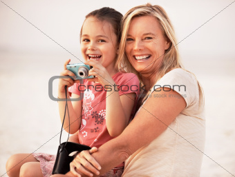 Portrait of mother with daughter photographing together