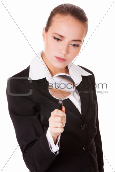Attentive business woman with loupe