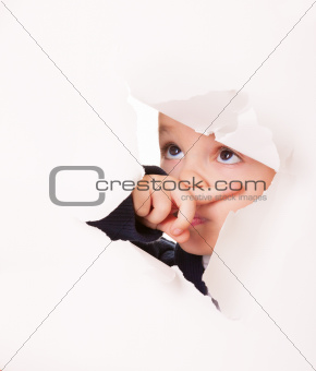 Guilty looking kid in a hole in white paper
