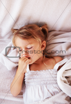 Cute female child about to fall asleep