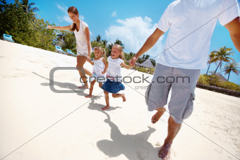 Cute children having fun on vacation with their parents