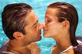 Smiling couple in water together