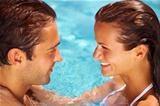 Smiling couple swimming together