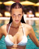 Sensual woman in the pool at a holiday resort