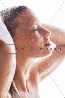 Closeup of beautiful young lady taking a nice relaxing shower