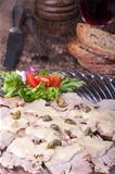 italian vitello tonnato on a glass plate