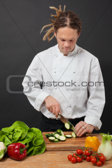 Chef with dreadlocks chopping