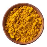 Wooden bowl full of ground turmeric