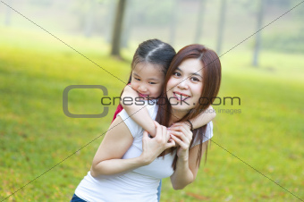 Happy Asian mother and daughter