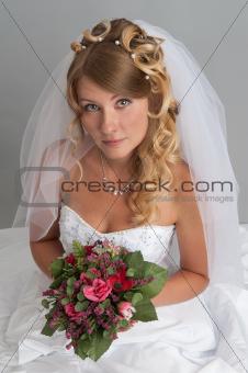 Beautiful blond bride studio portrait