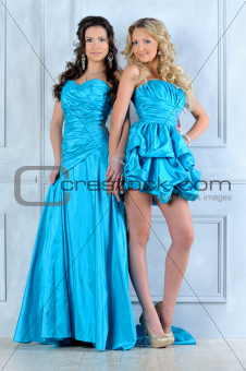 Two beautiful women in long and short evening dresses.