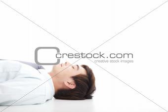 business man lying on floor for rest