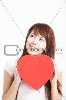 young woman holding red heart gift box