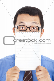 surprised businessman holding blank notebook