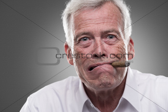 Puzzled senior man on gray background