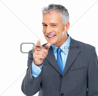 Senior businessman pointing at you against white