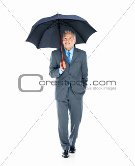 Safe business - Middle aged businessman under an umbrella