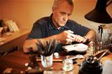 Jeweler working at his desk
