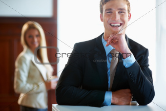 Joyful business man with female executive