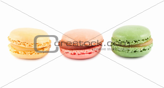 Colorful french macaroons in a row