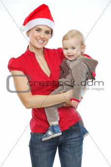 Portrait of mother and baby celebrating Christmas