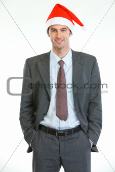 Portrait of smiling businessman in Santa's hat