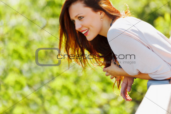 Smiling woman looking on copyspace on spring day
