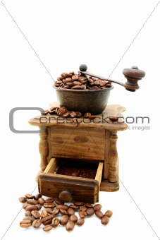 Old wooden mill with coffee beans.