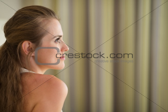 Profile portrait of thoughtful young woman looking on copy space