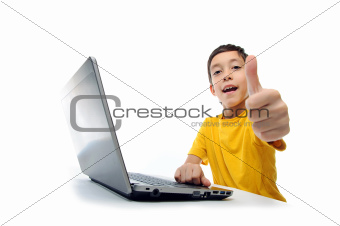 young boy in yellow t-shirt with laptop showing thumbs up at cam